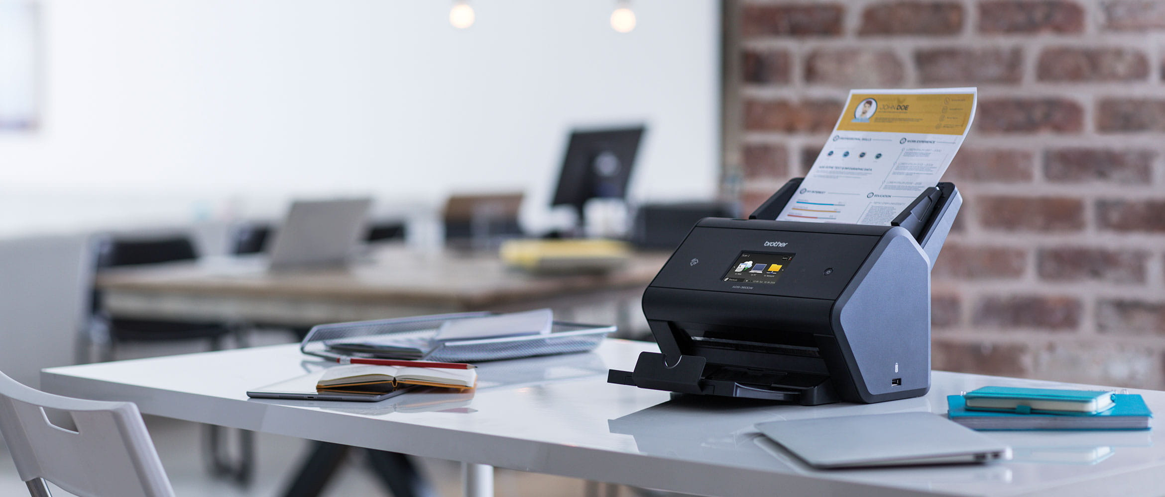 Lady using a Genuine Brother document scanner at her desk