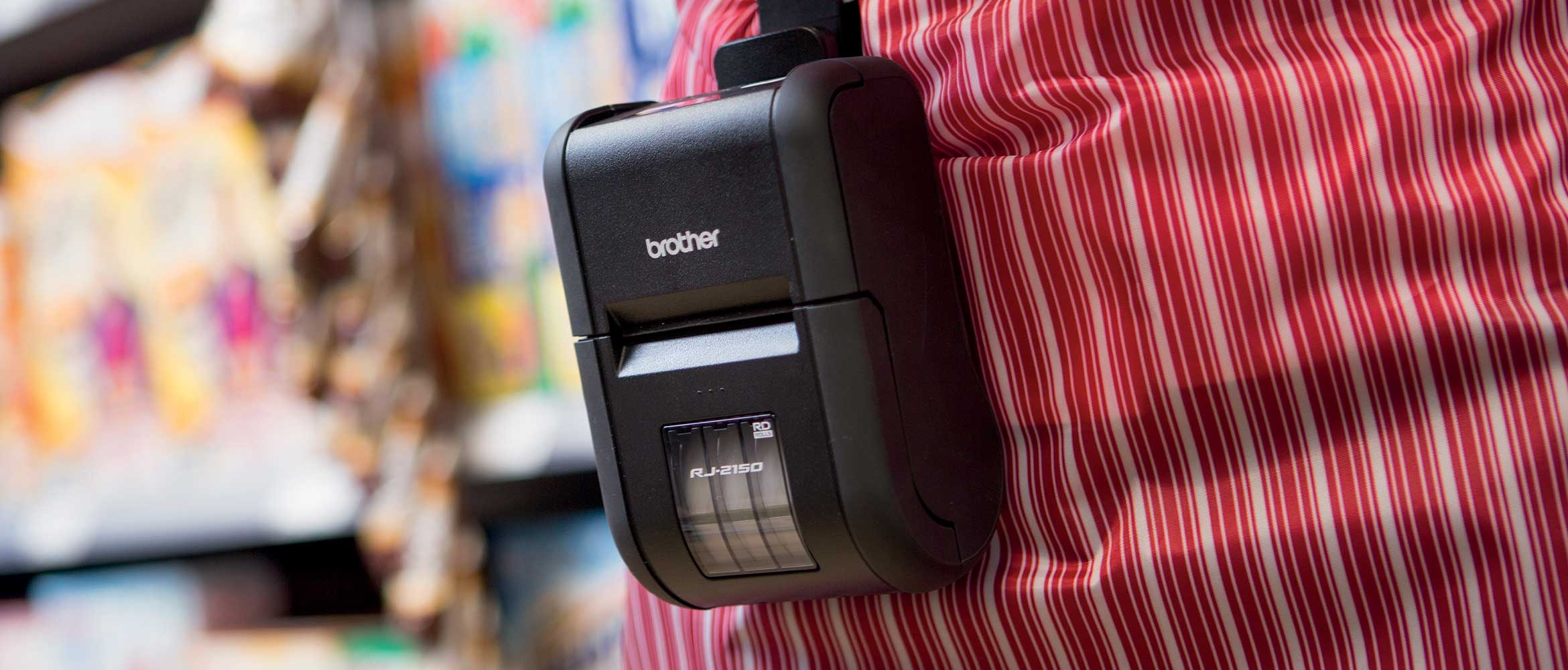 Shop assistant wearing a Brother mobile printer